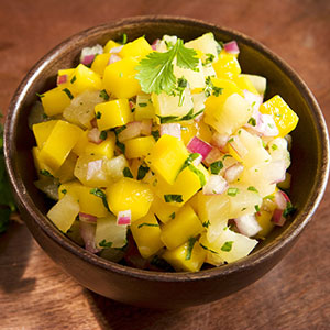 Cup of pineapple mango salsa