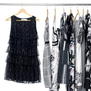 Black and white clothes on a rack