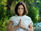 Meditating woman clearing her mind