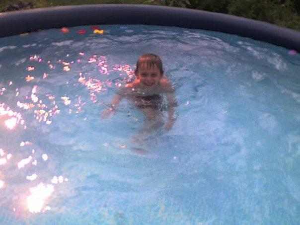 Swimming in his pool at home