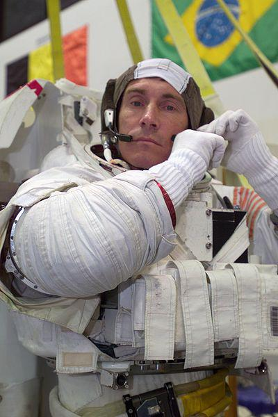 Cosmonaut Sergei K. Krikalev, Expedition 11 commander representing Russia's Federal Space Agency, dons a training version of the Extravehicular Mobility Unit (EMU) space suit prior to being submerged in the waters of the Neutral Buoyancy Laboratory (NBL) near the Johnson Space Center (JSC)