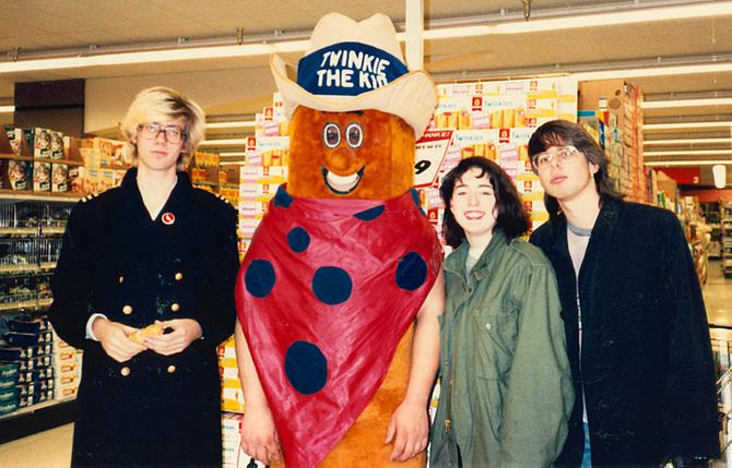 "Grand Rapids, Michigan, 1986. Youths in grocery store posing with mascot ""Twinkie the Kid""."