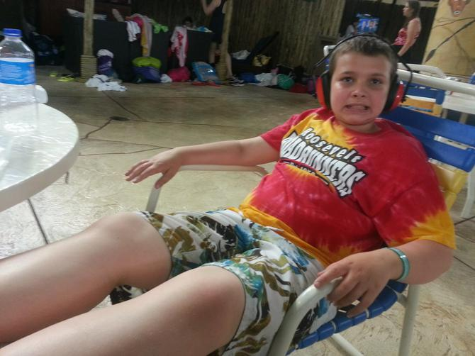Alex relaxing in a chair and taking a break from swimming.