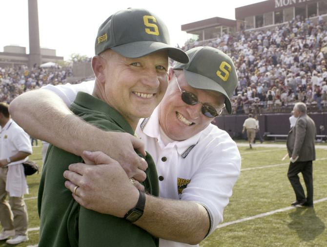 craig bohl and gene taylor celebrate after the bison beat
